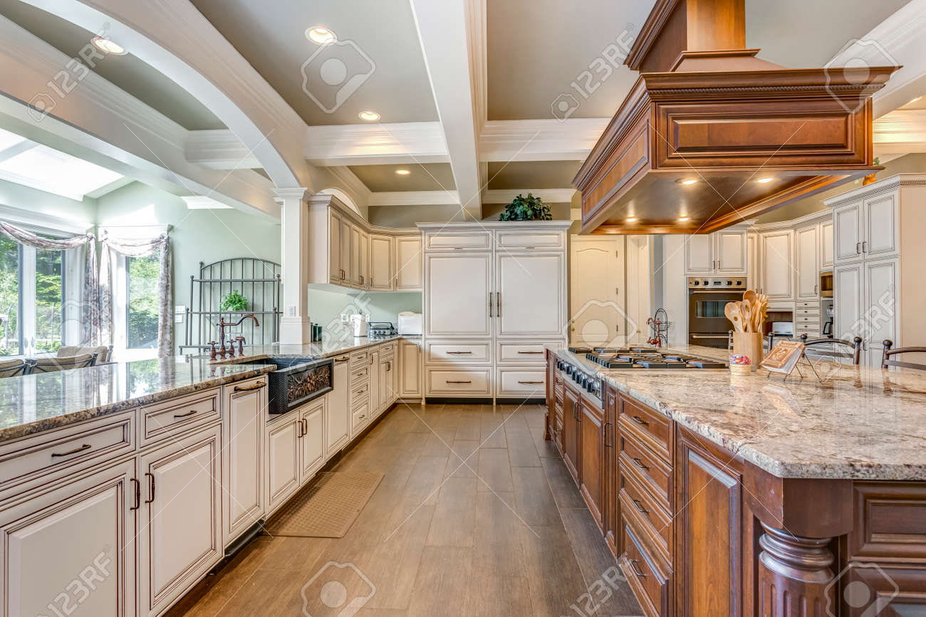 Stunning kitchen room design with large bar style island and coffered ceiling. - 108106291