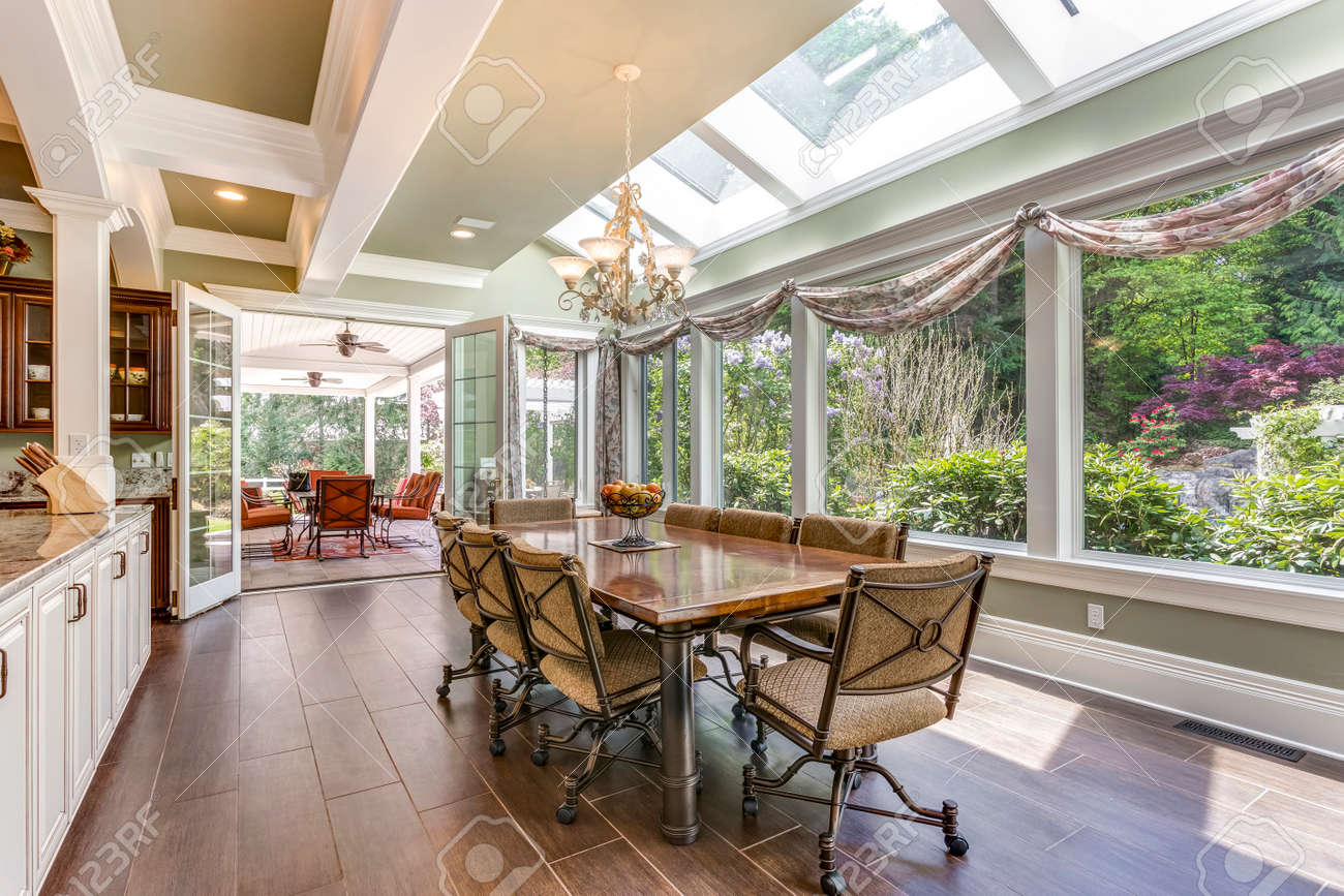 Sun filled dining area with skylight and coffered ceiling. - 108106292