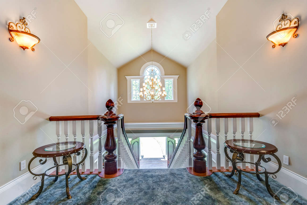 Stunning foyer with elegant staircase and vaulted ceiling. - 108106225