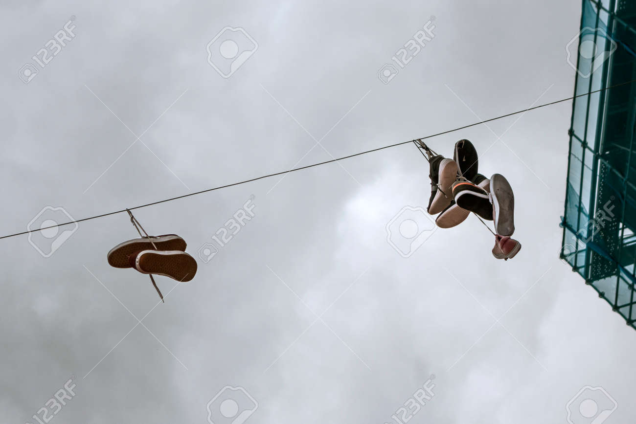 Sneakers Hanged Up On A Wire Stock Photo, Picture And Royalty Free ...