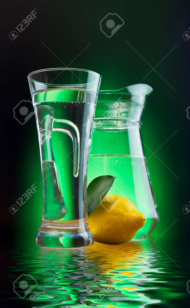 mineral water and lemon on a colored background Stock Photo - 12660403
