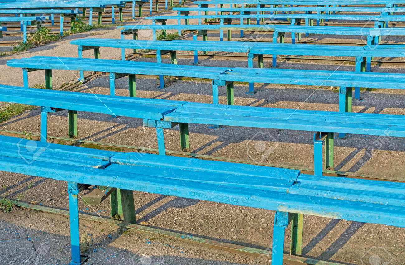 Tremendous Empty Wooden Benches Of Blue Color Are On Grandstand Old Stadium Unemploymentrelief Wooden Chair Designs For Living Room Unemploymentrelieforg