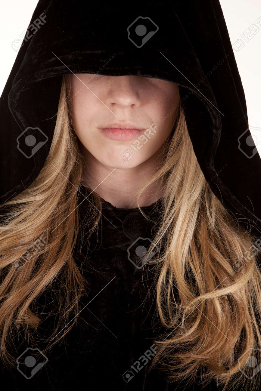 8d9cae076b8 A girl with a hood over her eyes with a sad expression on her face.