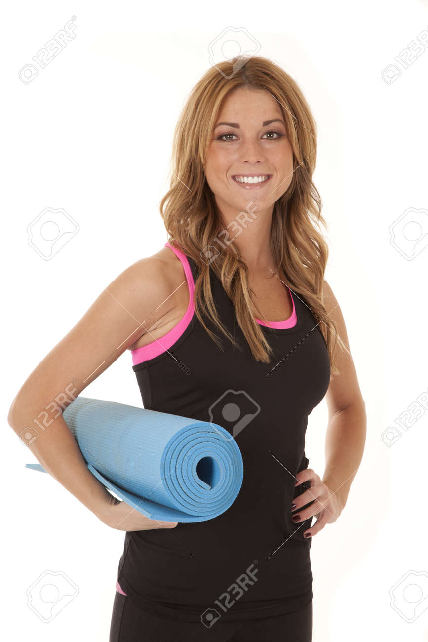A woman holding on to an exercise mat with  a smile on her face. Stock Photo - 12104491