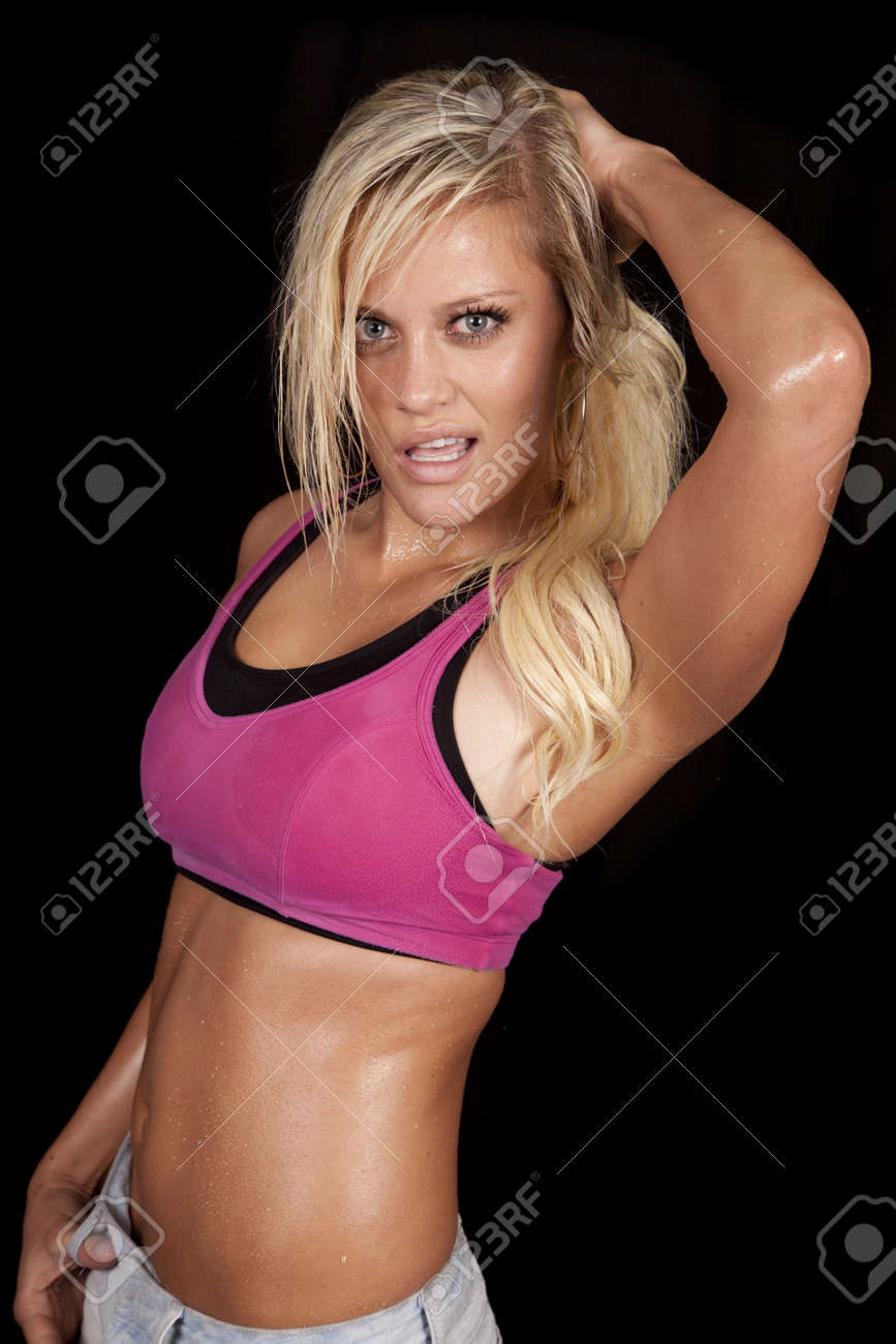 ... sports bra. A woman has her hand on her hair and is covered in sweat.  She is dddb2d9efb25