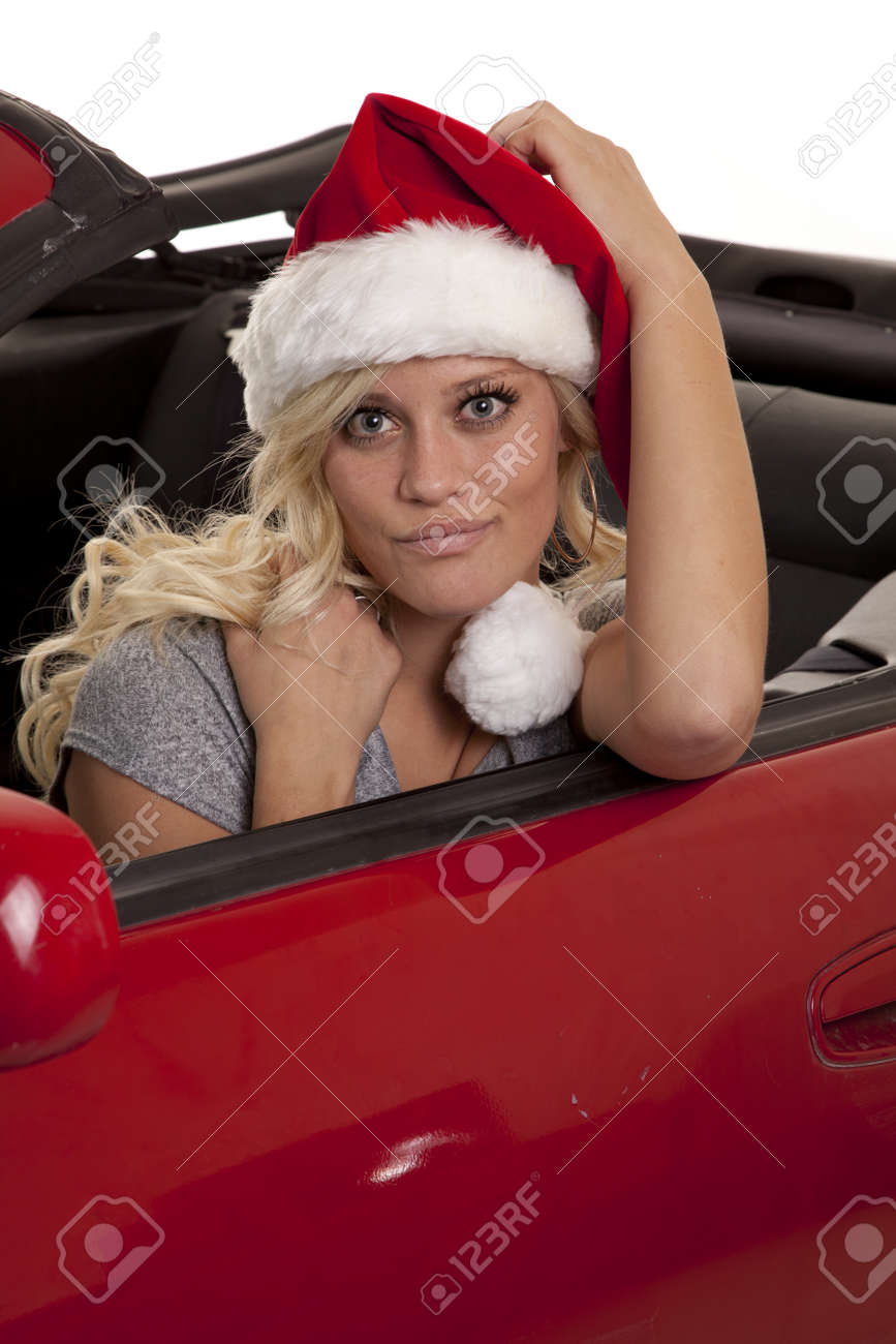 A woman wearing her Santa hat with a big smile on her face. Stock Photo - 12104358