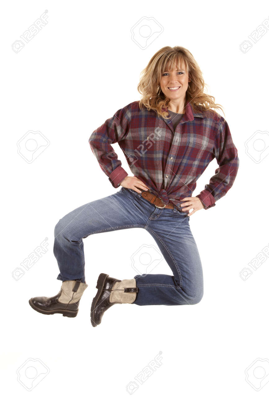 A Woman Showing Her Excitement Jumping Up In The Air Wearing Stock