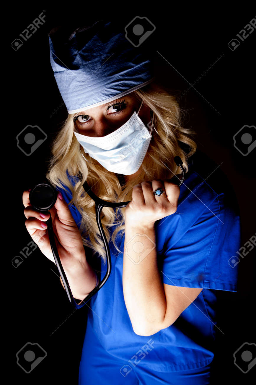 A woman doctor or nurse with a stethoscope in the dark. Stock Photo - 14611529