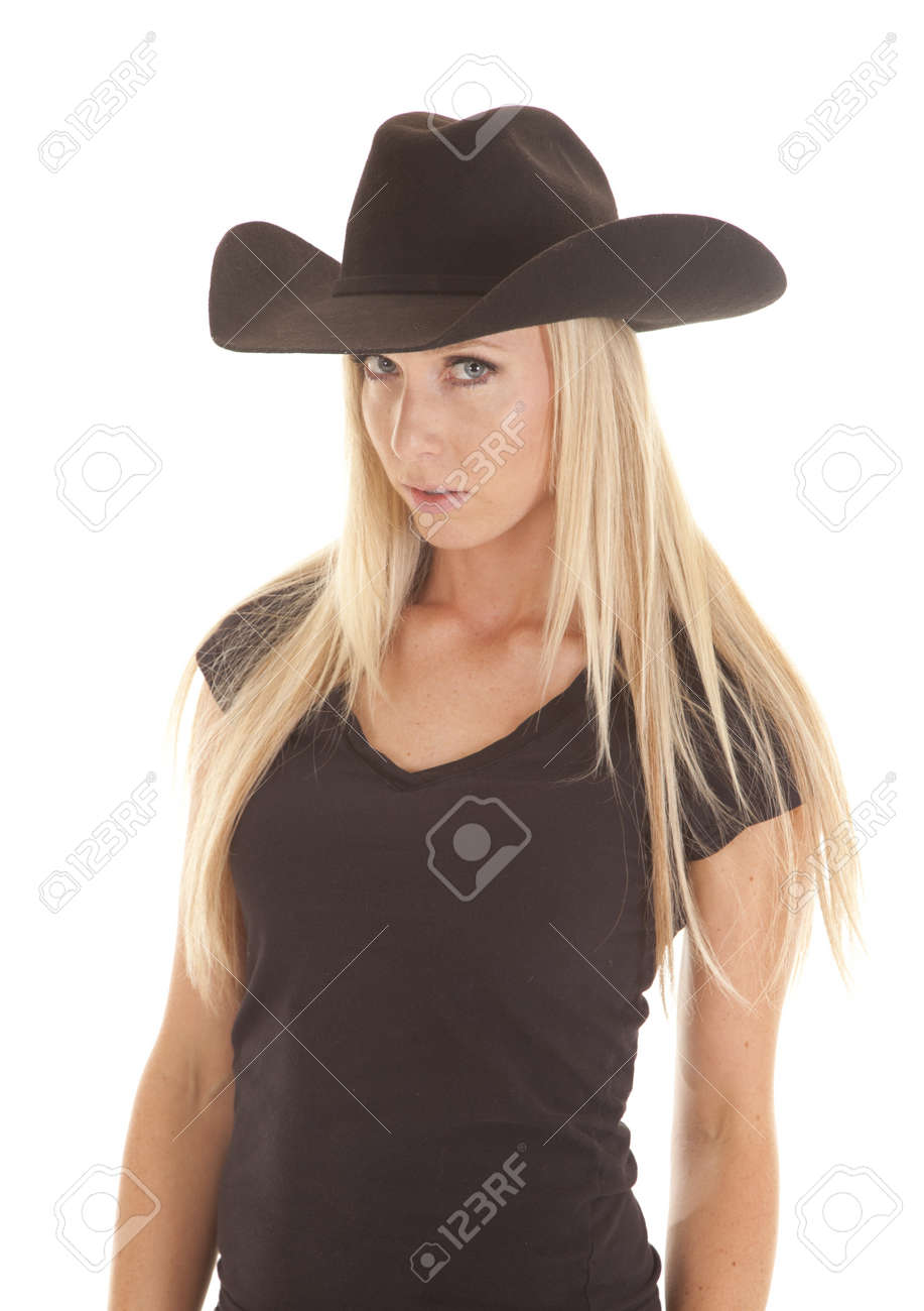 A cowgirl in her black western hat with a serious expression on her face. Stock Photo - 15726793