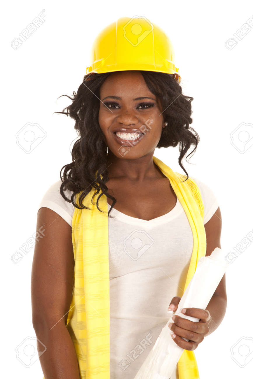 a woman in her construction hard hat holding on to her blueprints with a smile on her face. Stock Photo - 15849200