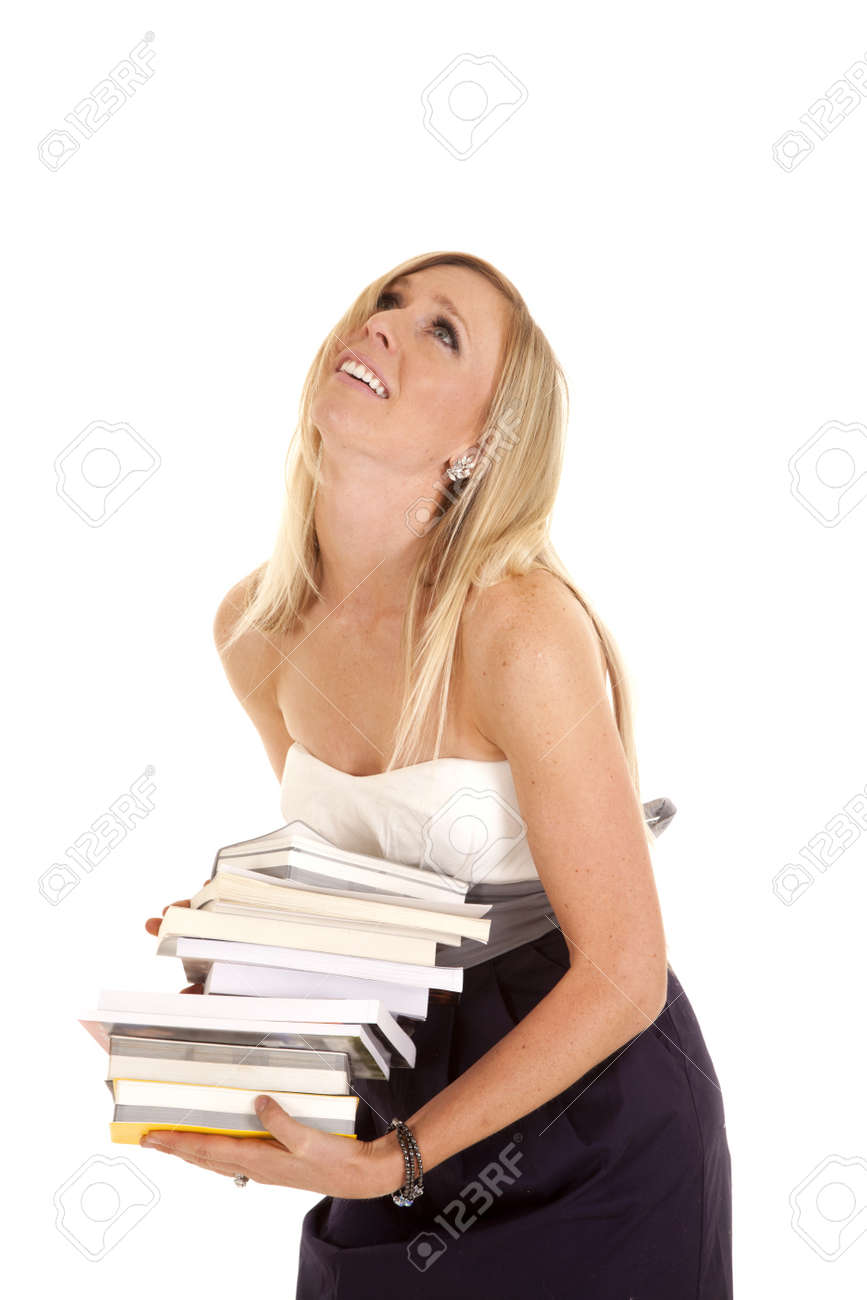 A woman with a stack of books tired of carrying them. Stock Photo - 15849498