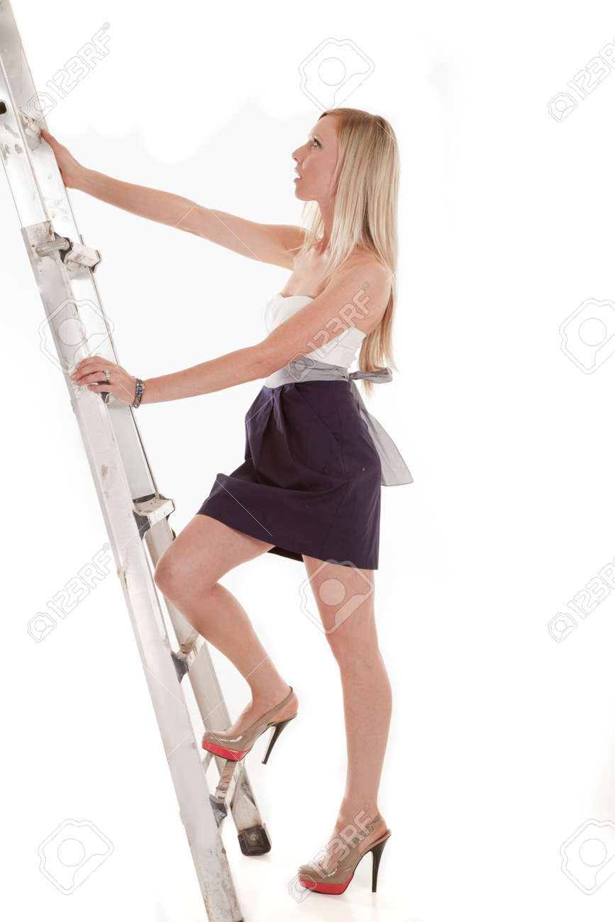 a w climbing up the ladder in her heels and dress stock photo stock photo a w climbing up the ladder in her heels and dress