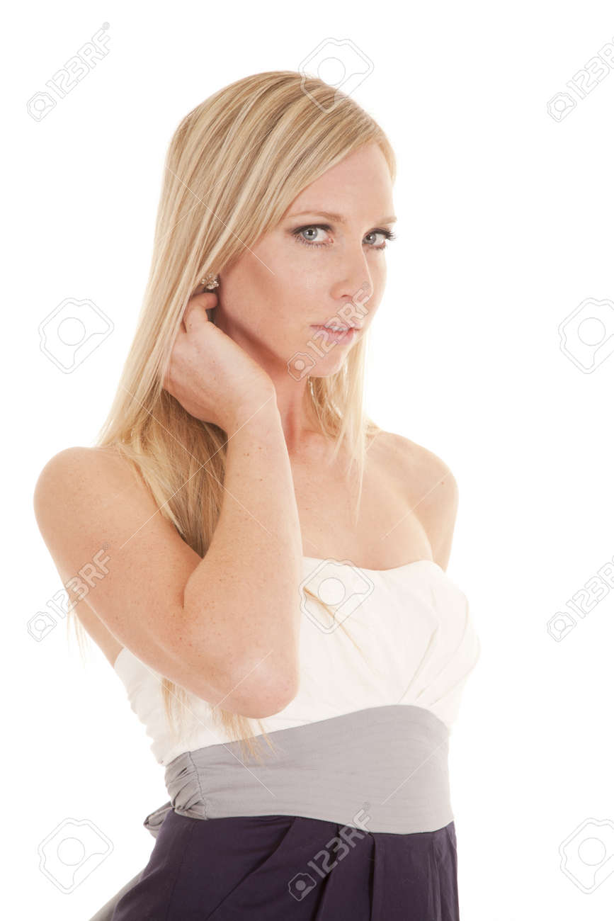 A woman in her dress with her hand by neck serious. Stock Photo - 15849499