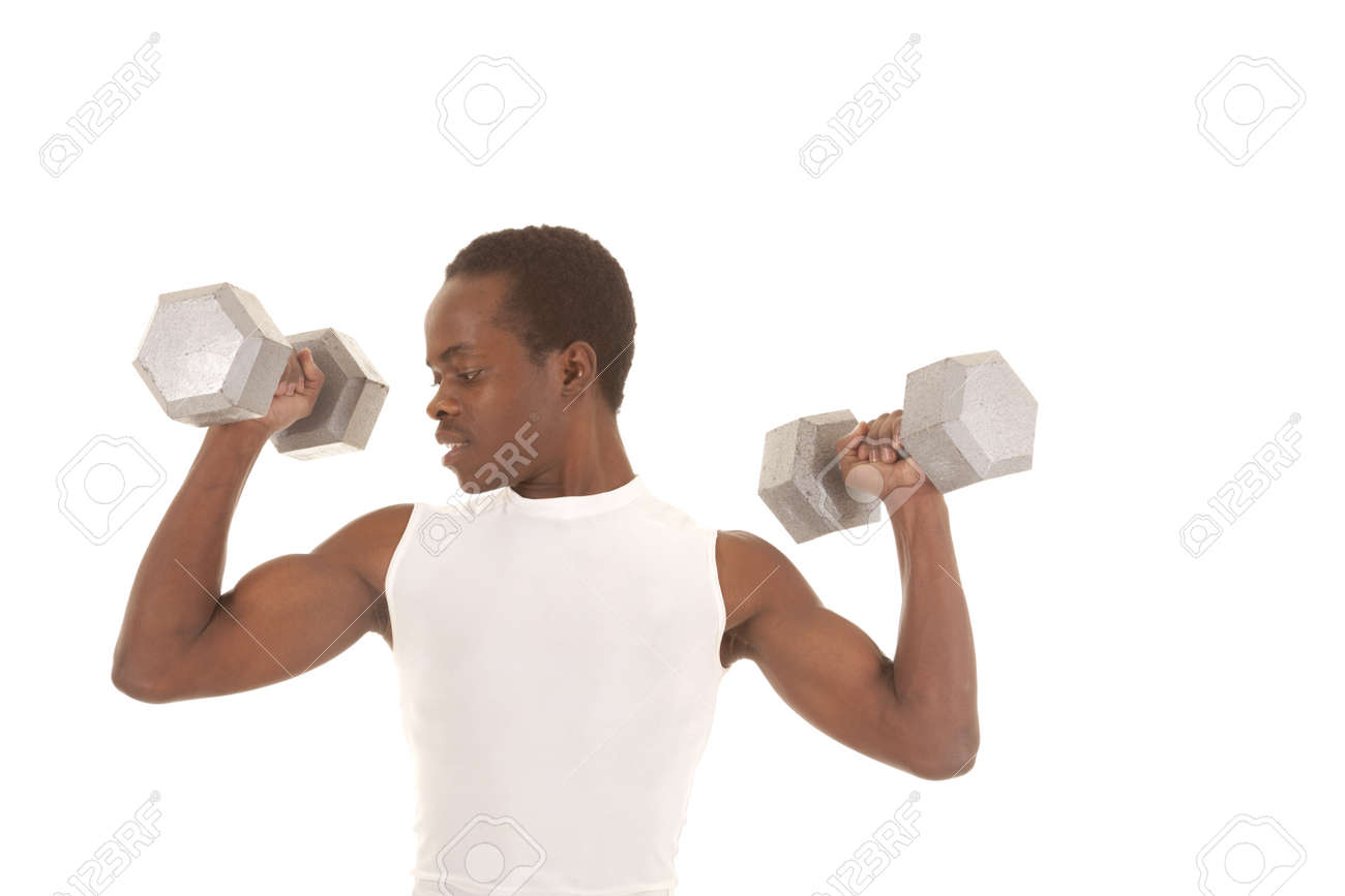 A man working out with big weights doing arm curls looking at his bicept. Stock Photo - 16035379