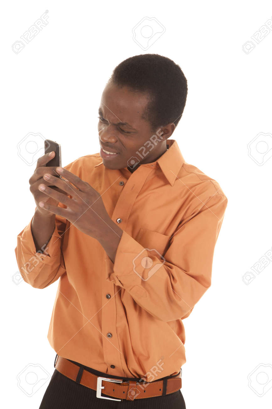 A man with a confused expression  looking at his phone. Stock Photo - 16035238