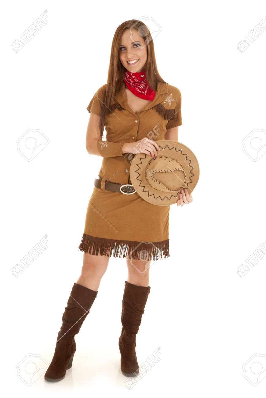 A Woman In Her Cowgirl Costume With A Big Smile On Her Lips Stock