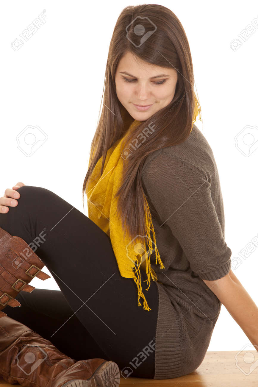 a woman sitting on a bench looking down. Stock Photo - 18187523