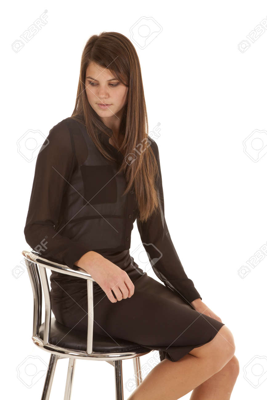 A woman sitting on her stool with a sad expression on her face not sure what to be expecting. Stock Photo - 18187141