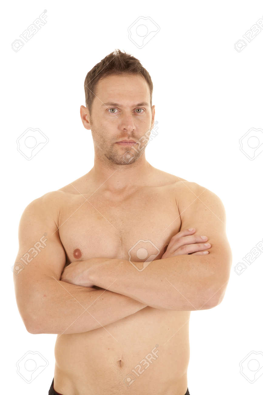 A Man With No Shirt On And Arms Folded With A Serious Expression