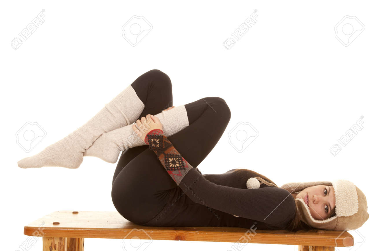A woman laying on her bench in her warm long johns, long socks and a warm hat. Stock Photo - 18187096