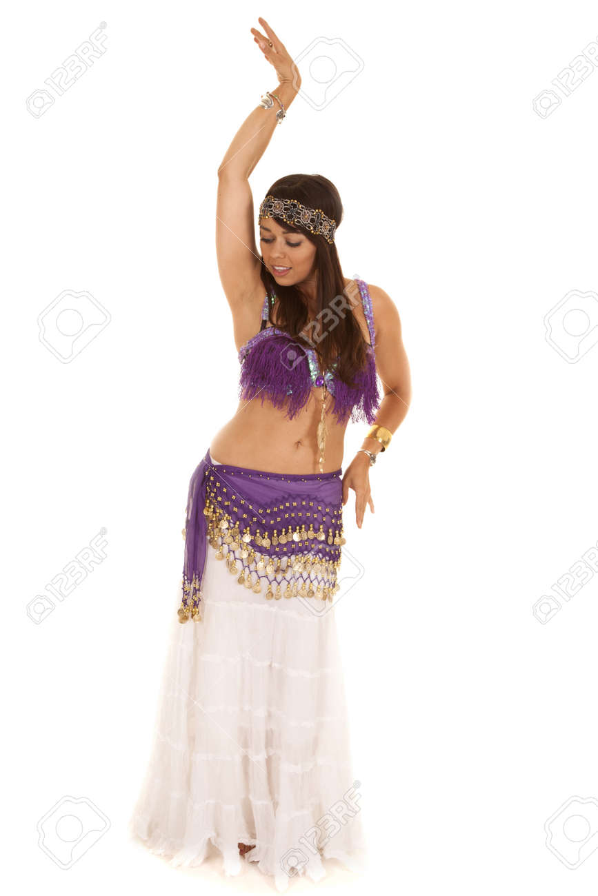 0e4fa2005 A woman belly dancing in her purple dress showing off her moves. Stock  Photo -