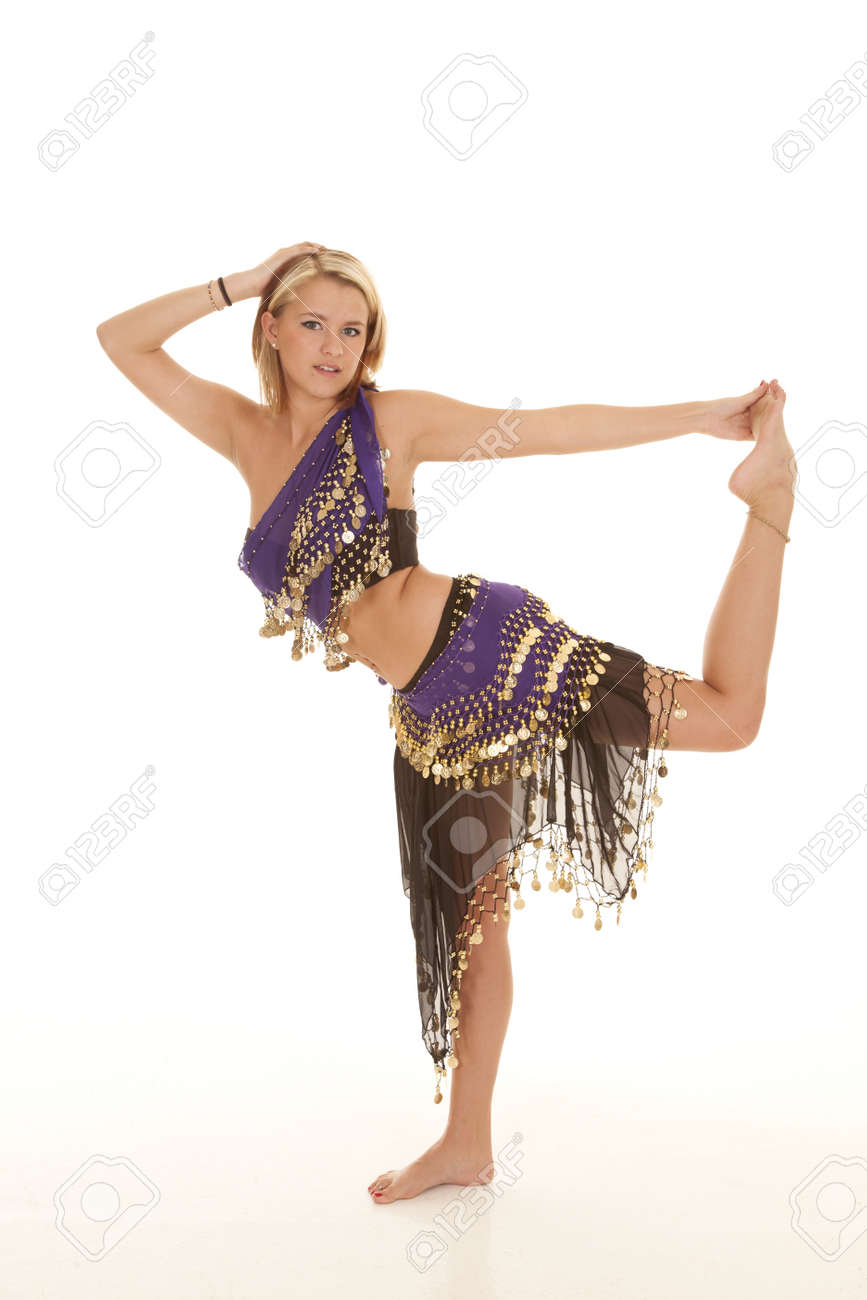 ce2ed6ea3 A woman in her belly dancing clothes holding on to her foot, with a small