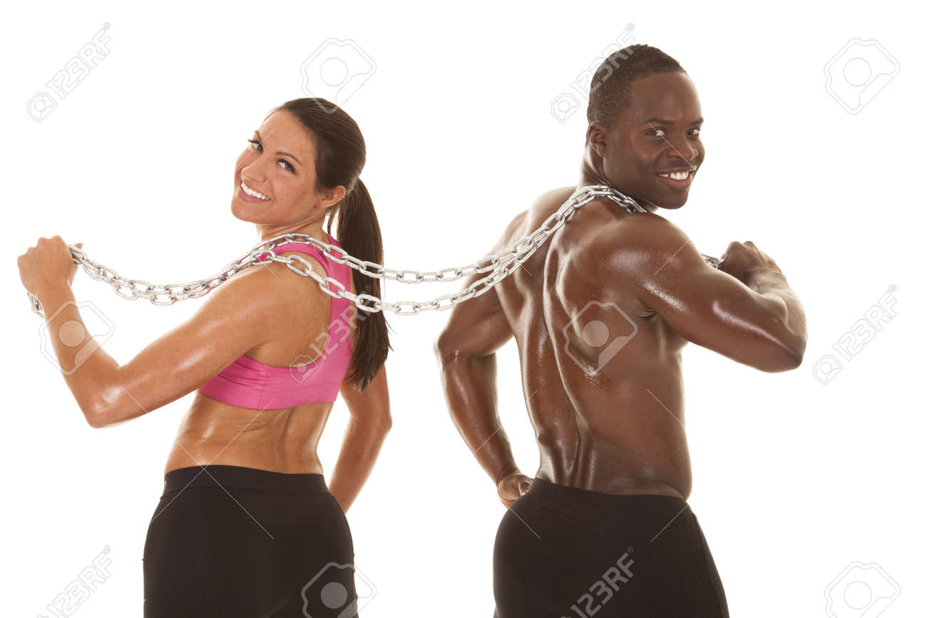 Interacial Ideal an interacial couple working out with a chain smiling. lizenzfreie