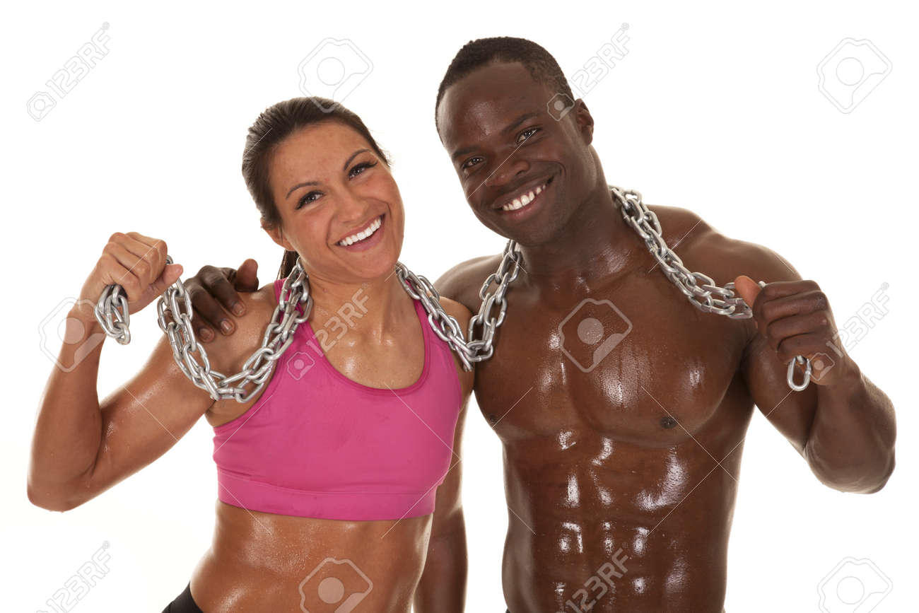 Interacial Amazing an interacial couple working out with a chain smiling. stock photo
