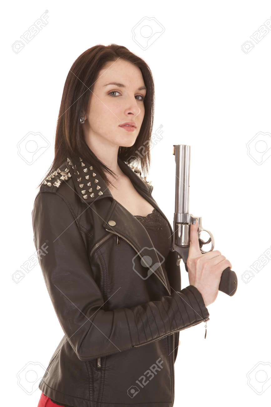 A woman in a leather jacket holding up a gun. Stock Photo - 21354175