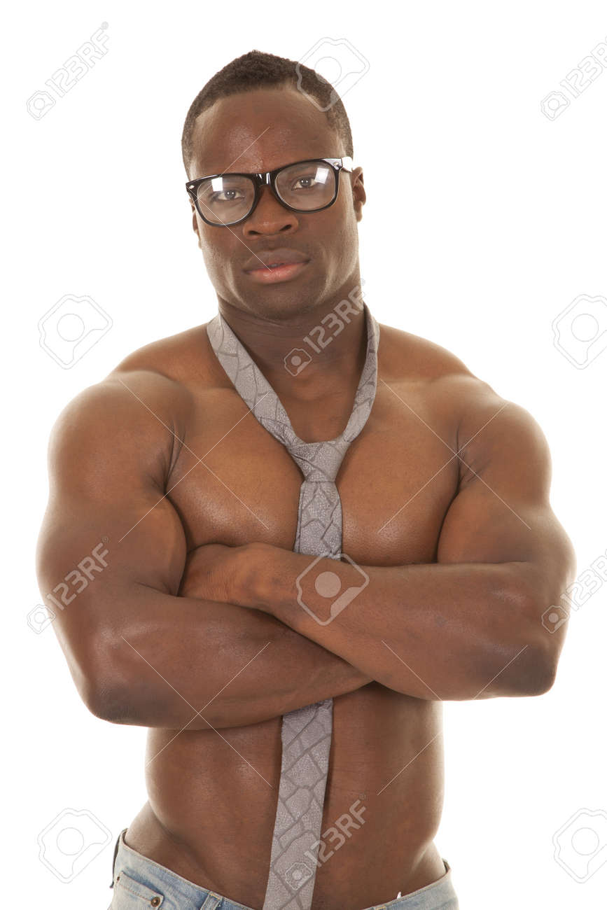 A Man With No Shirt On Wearing A Neck Tie And Glasses Showing