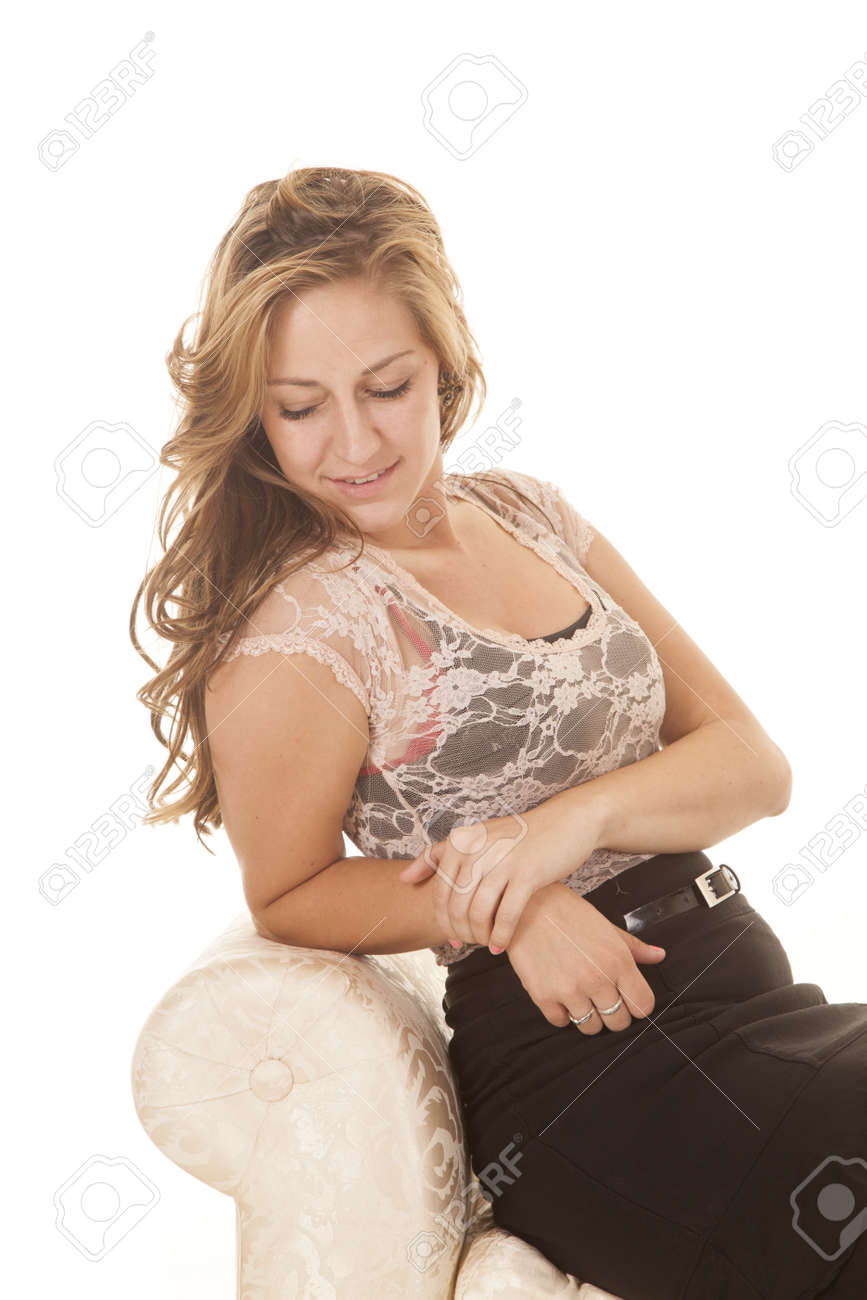 A woman in a lace top sitting looking down Stock Photo - 21513599