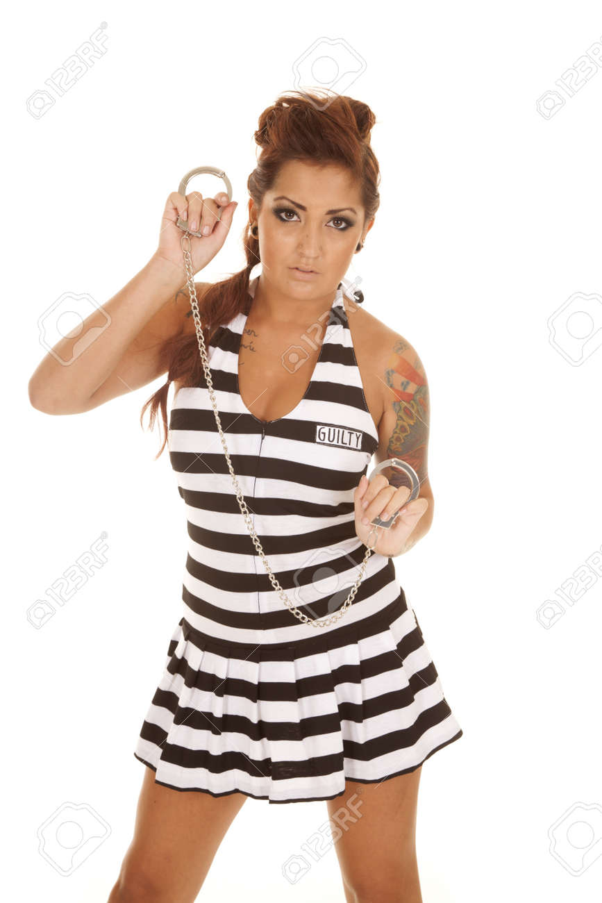 A woman with handcuffs in her hands and tattoos. Stock Photo - 21726622