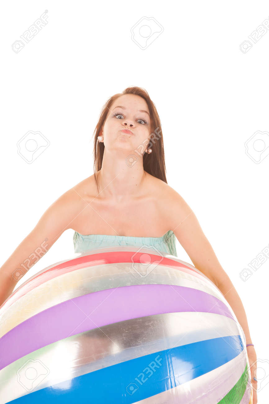 A girl is holding a beach ball with a crazy face. Stock Photo - 22205663