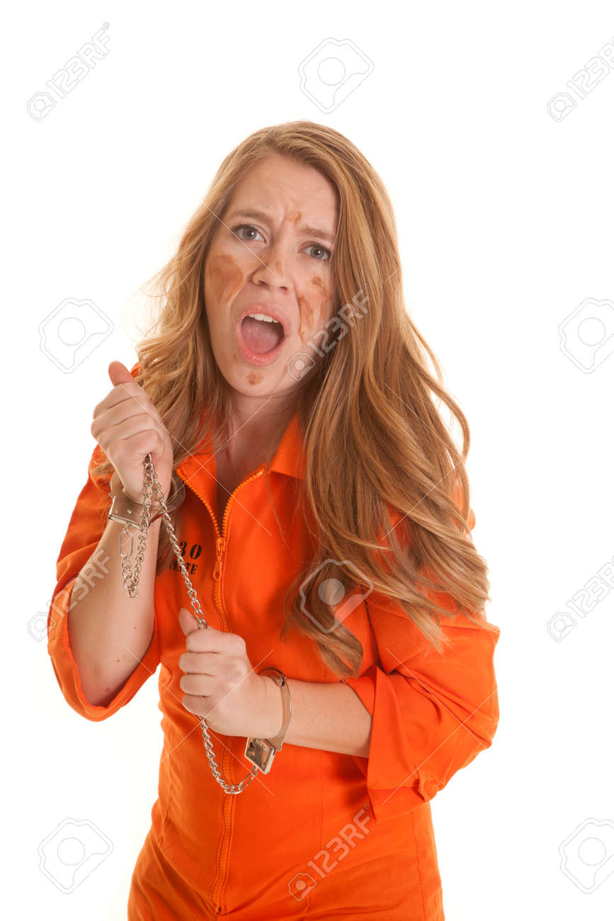A Woman In An Orange Jumpsuit In Handcuffs Mad. Stock Photo ...