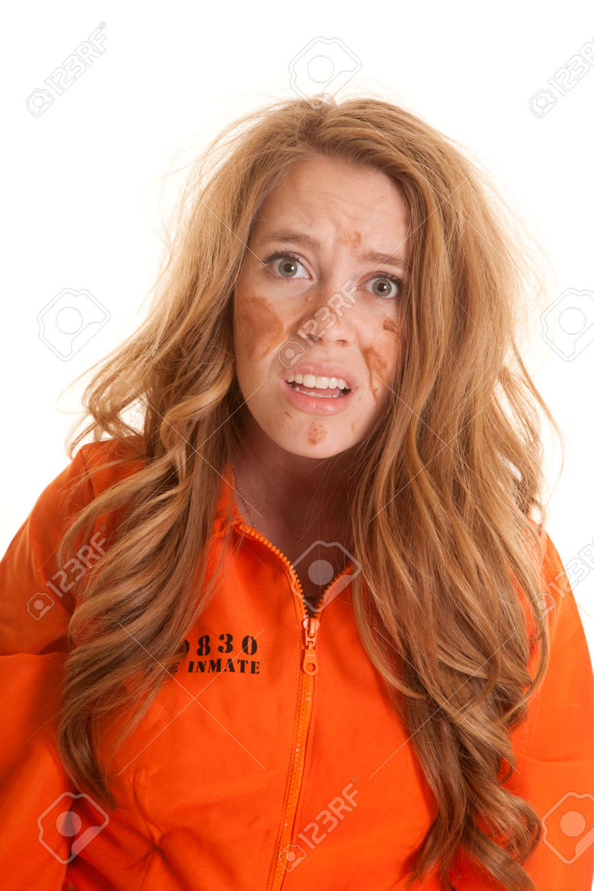 A Woman In An Orange Jumpsuit Is Very Messed Up Looking. Stock ...