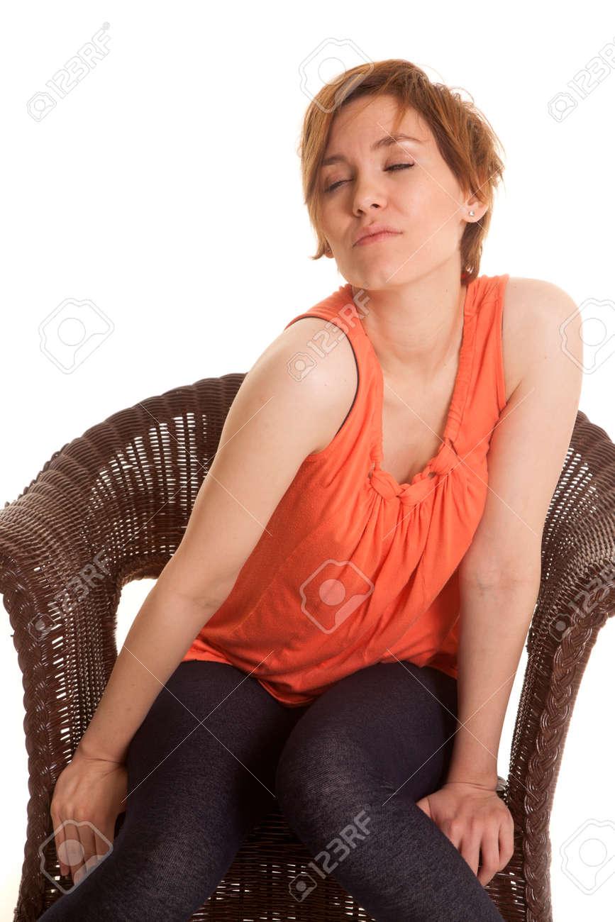 Eine Lateinische Frau In Einem Orange Trägershirt Das In Einem