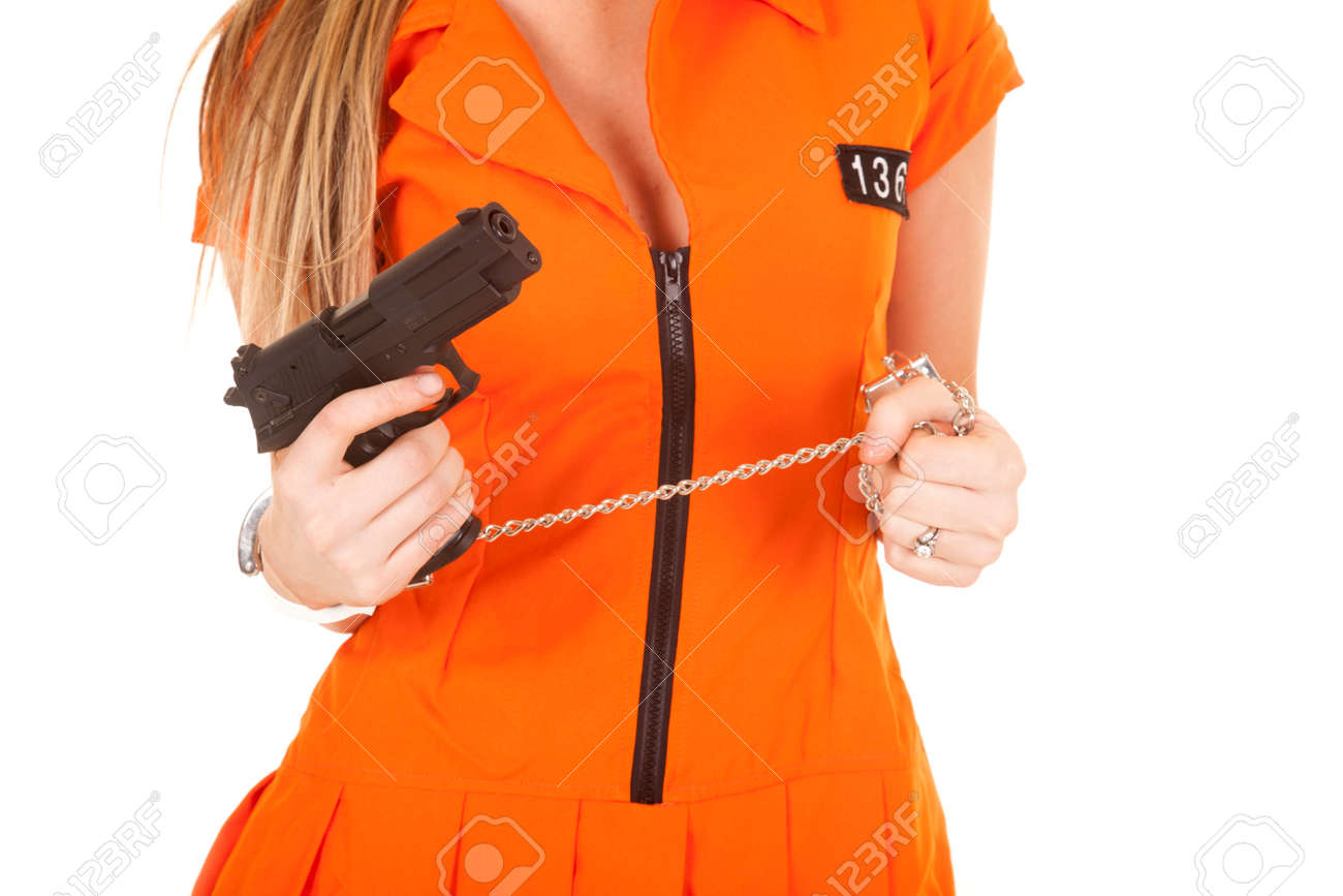 a woman in her orange jump suit wearing hand cuffs. Stock Photo - 28112632