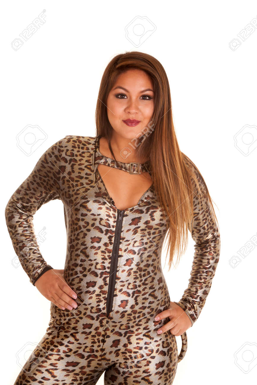 a woman in her leopard halloween costume with a smile on her face stock photo
