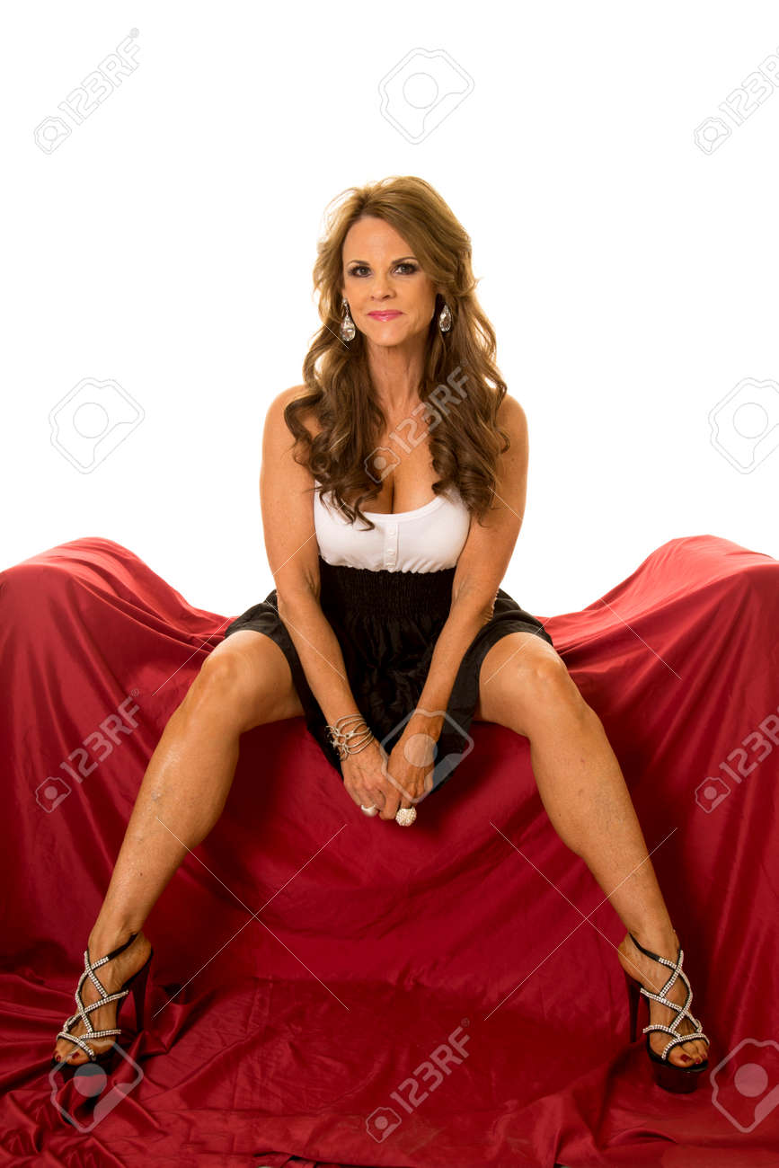 Mature women legs A Mature Woman Sitting On Her Couch With Her Legs Apart In Her Formal Dress Stock Photo Picture And Royalty Free Image Image 51649334