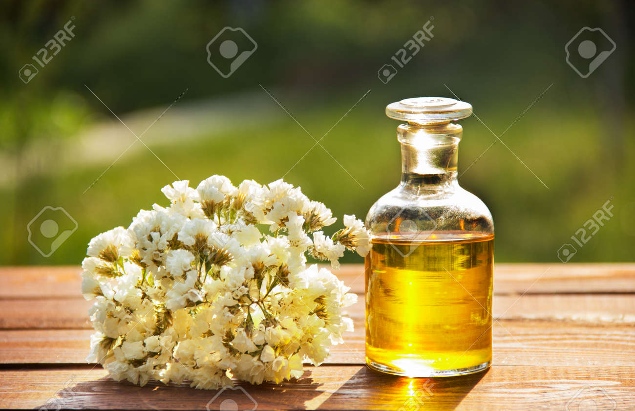 Aromatic essential oil and white flowers spa concept cosmetics aromatic essential oil and white flowers spa concept cosmetics and spa care stock mightylinksfo
