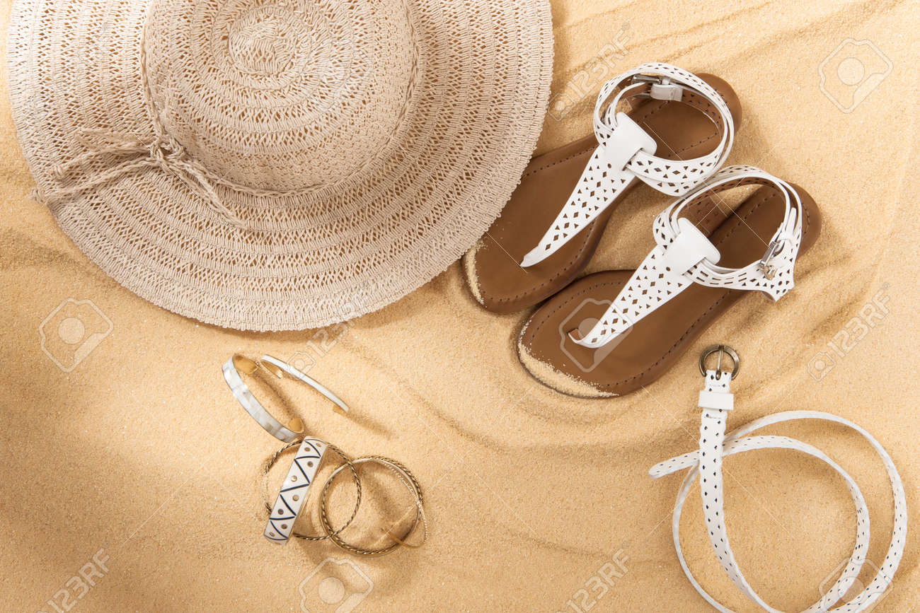 83a09005898 set of bright summer clothes for the beach on the golden sand Stock Photo -  66521255