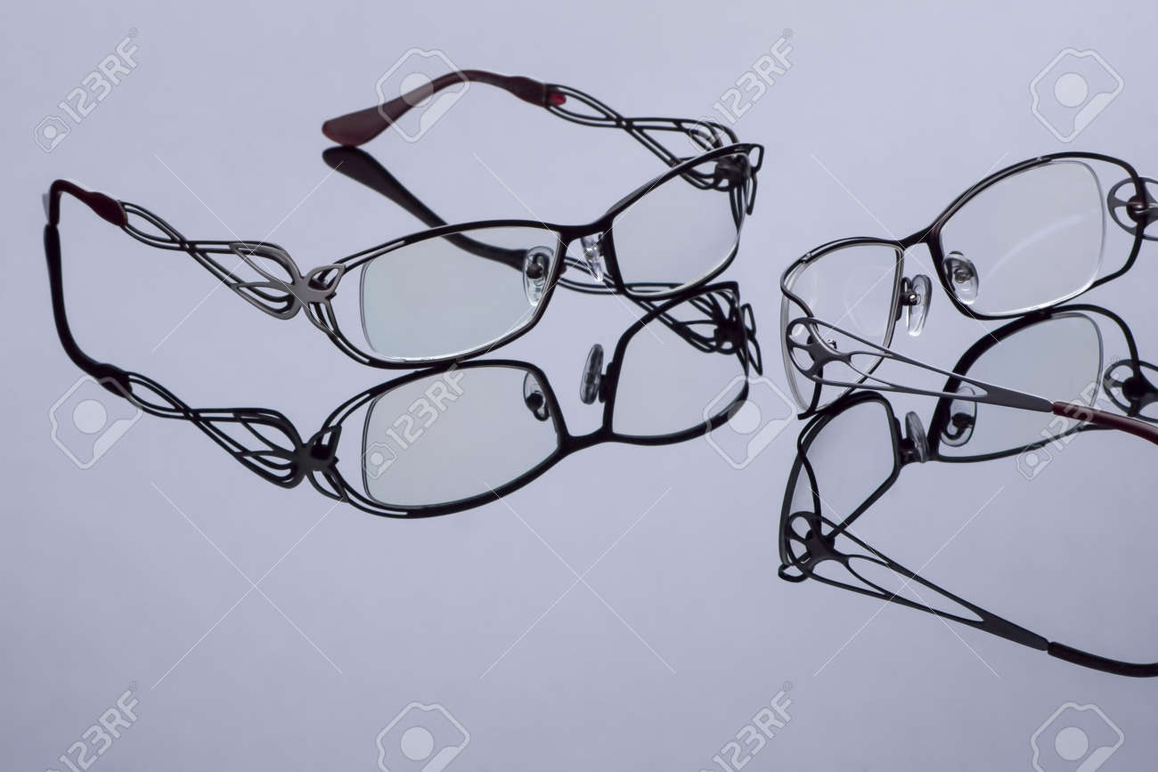 Modern Optical Glasses On A Dark Surface With Mirror Reflection