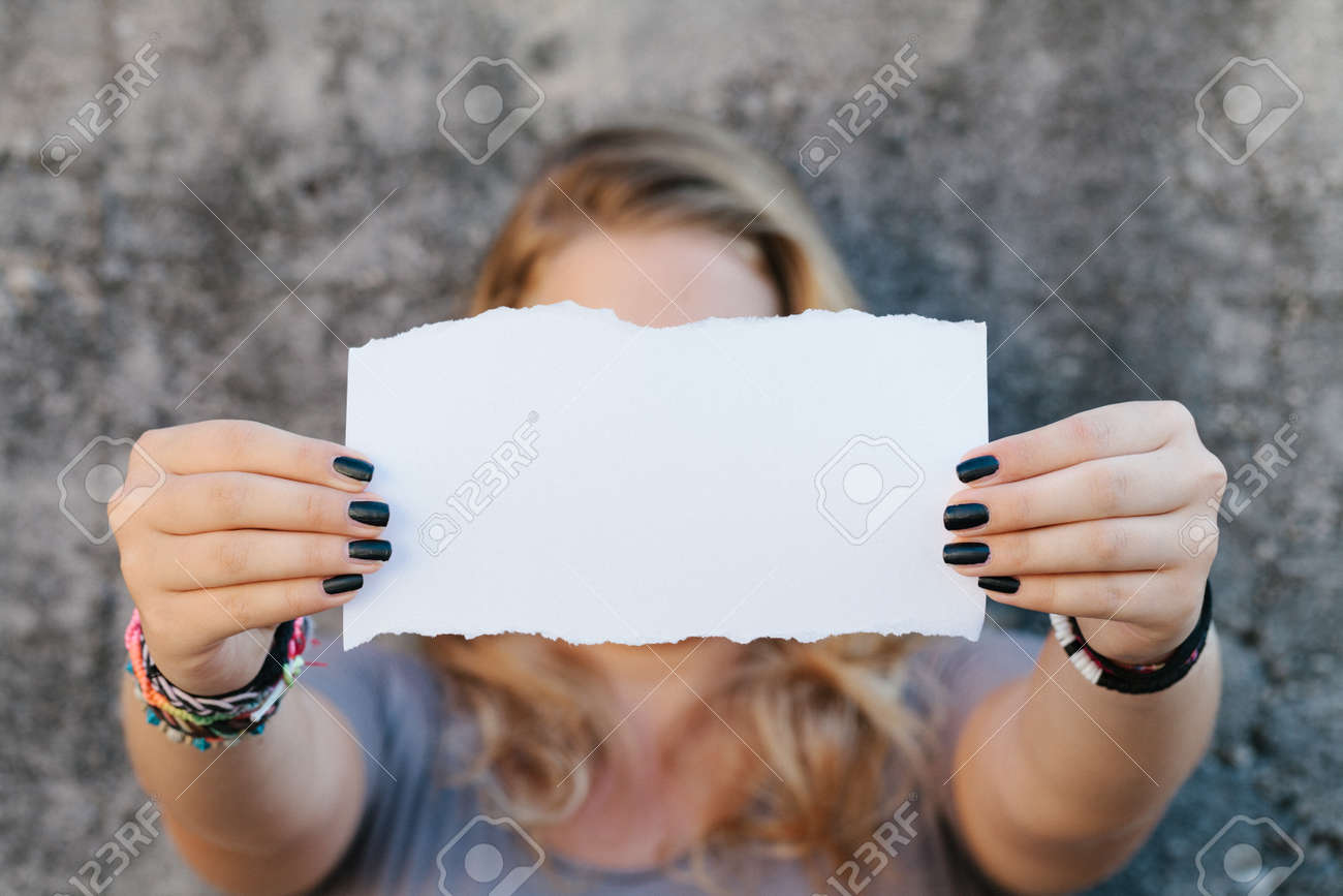 teenage girl in casual clothes holding blank sheet of paper Stock Photo - 23410325