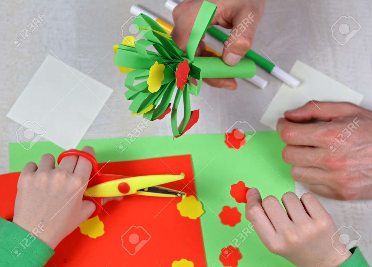 Child Cut Out Of Colored Paper Kid Making Birthday Card Father And Son Preparing
