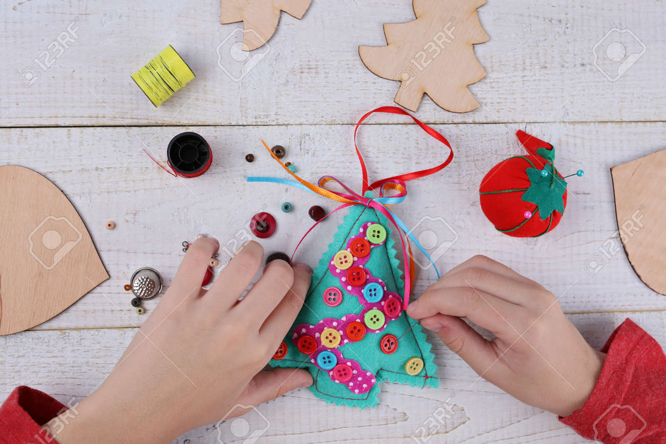 child making felt christmas tree decoration ornament kids art stock photo picture and royalty free image image 77242322 123rf com