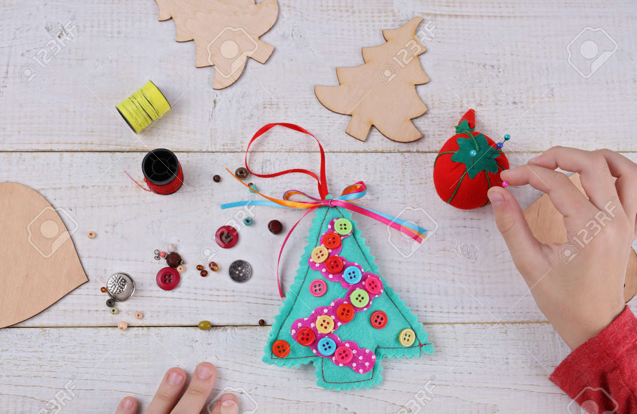 Christmas Preschool Art Projects.Child Making Felt Christmas Tree Decoration Ornament Close Up
