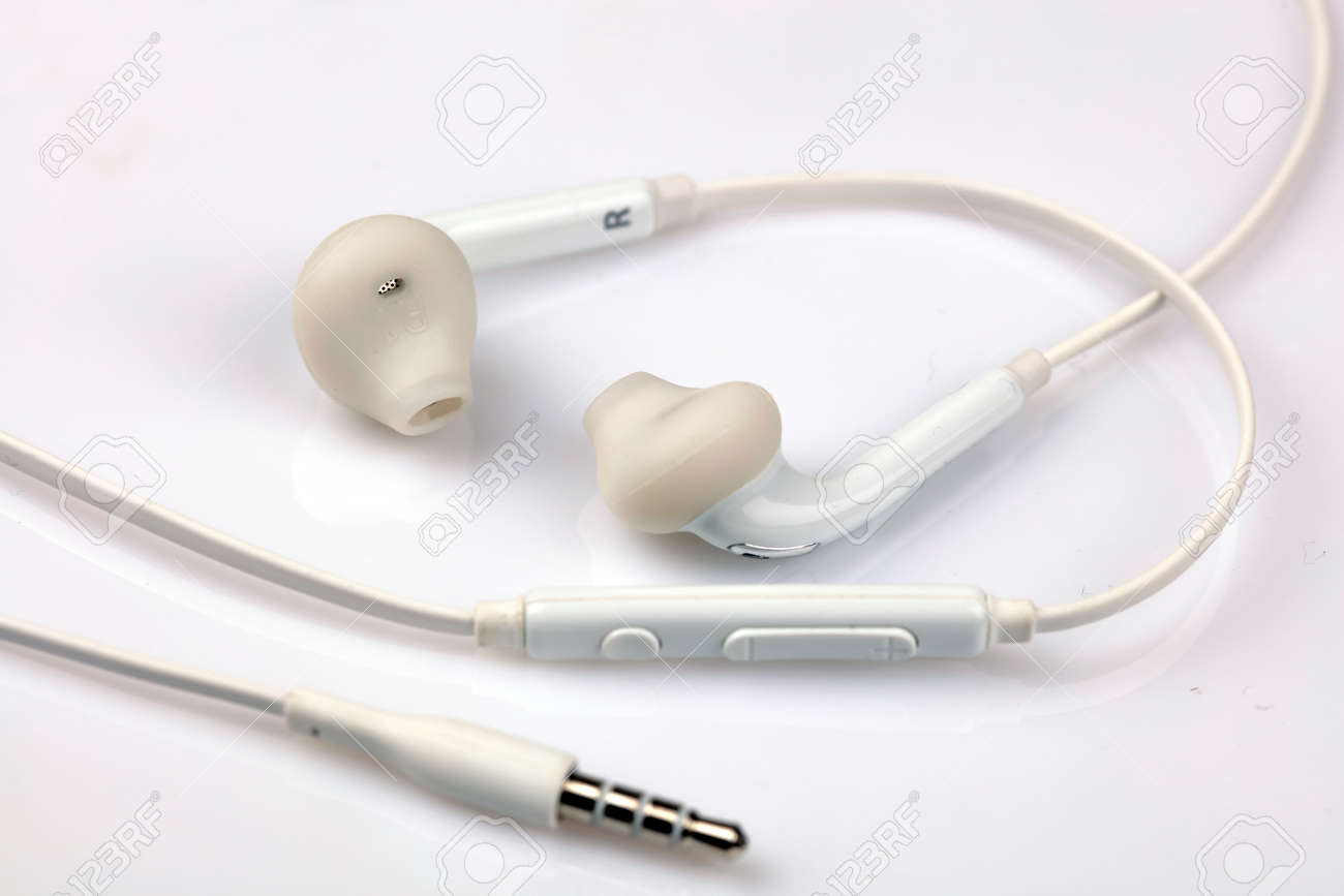 Close Up On Modern Earphones Headphones On White Background Stock Photo Picture And Royalty Free Image Image 77180869