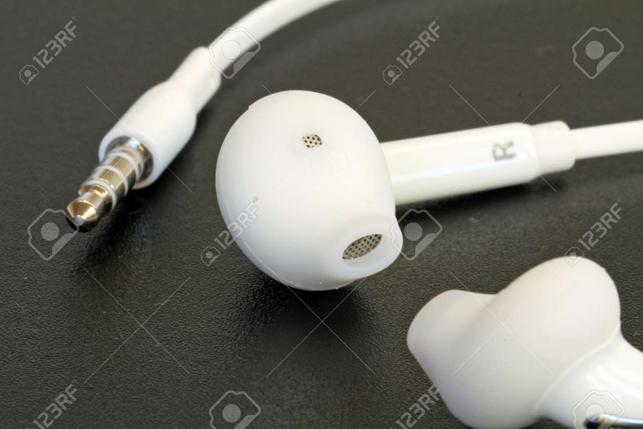 Close Up On Modern Earphones Headphones On Black Background Stock Photo Picture And Royalty Free Image Image 77177896