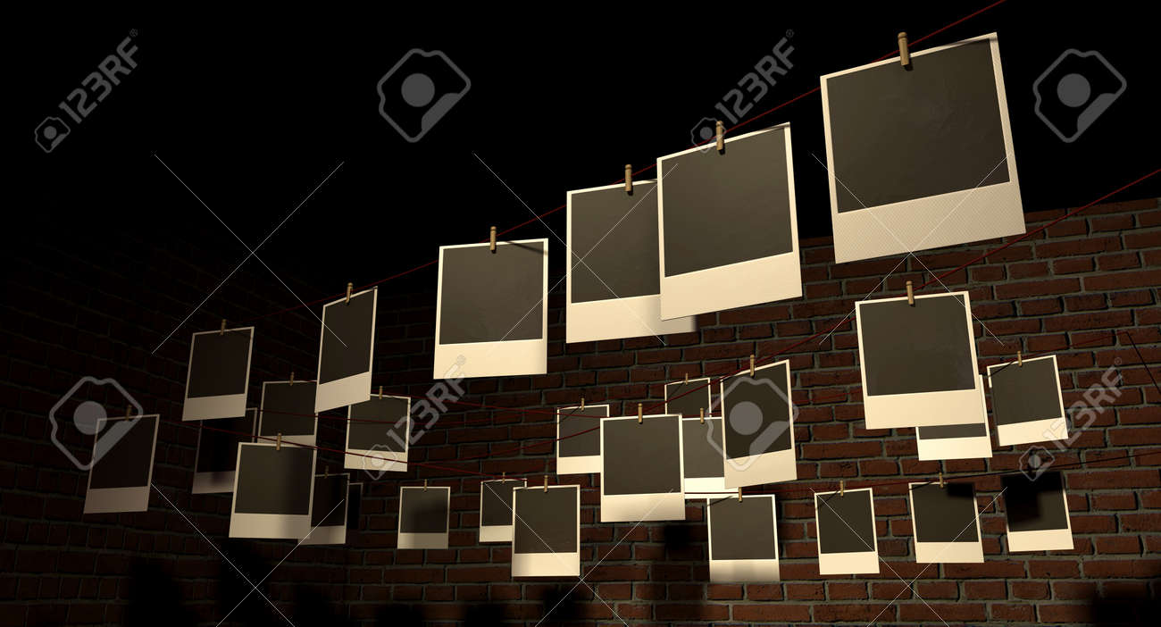 A gallery of blank polaroids pegged onto multidirectional red strings infront of a facebrick wall Stock Photo - 14605303