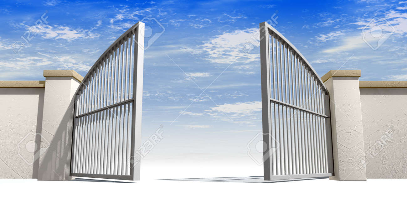 a solid garden wall with open metal gates with a blue sky in stock
